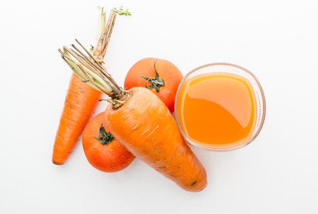 carot: Tomato and carot juice in a glass