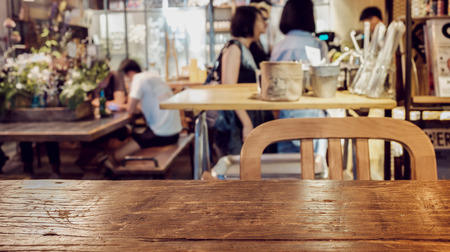 Focus on the foreground table . Living in a coffee shop