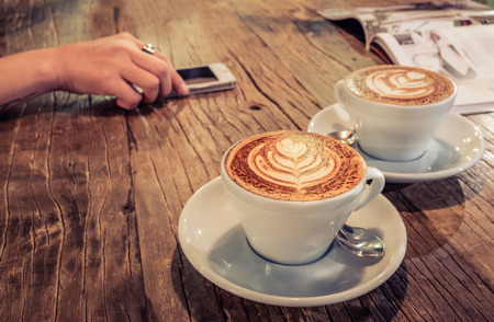 latte: cup of coffee on table in cafe. Stock Photo