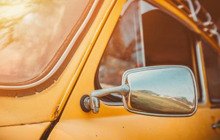 vintage car: Headlight yellow vintage car. The morning light vintage.