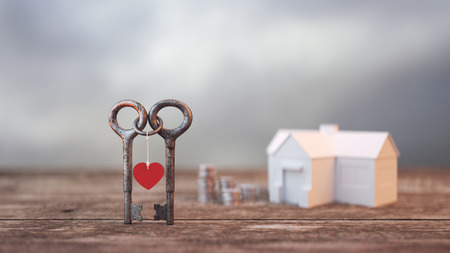 Two keys looped together Background and a pile of money.heart.