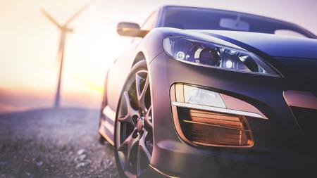 Het beeld voor de scène van de sportwagen erachter als de zon ondergaat met windturbines achterin.