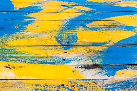 The wood was drained in yellow and blue. Stock Photo