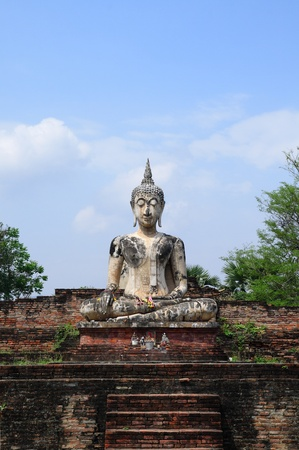 Buddha sit on ruins temple in sukhothai unesco photo