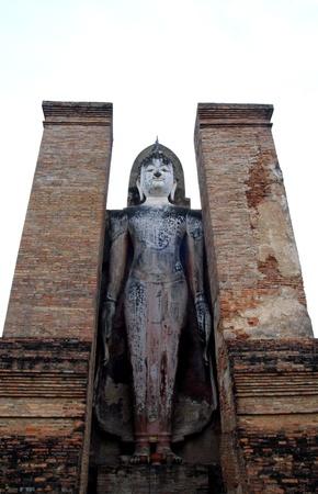 Sukhothai buddha Stand in Sukhothai historical park, thailand photo