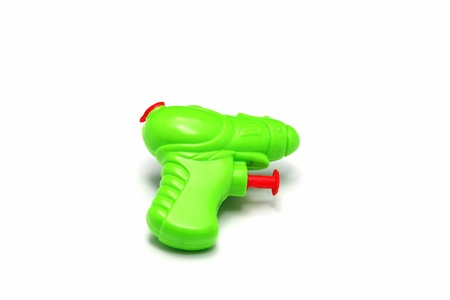 bright green water gun isolated on white background photo