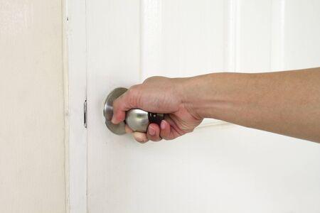 Man hand opening door photo