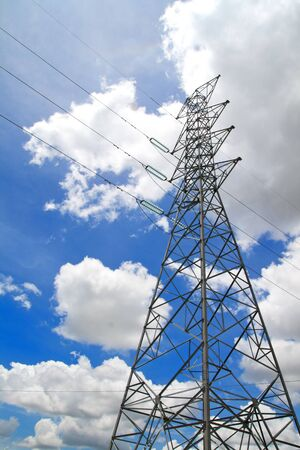 High-voltage towers under blue sky. Stock Photo - 9772213