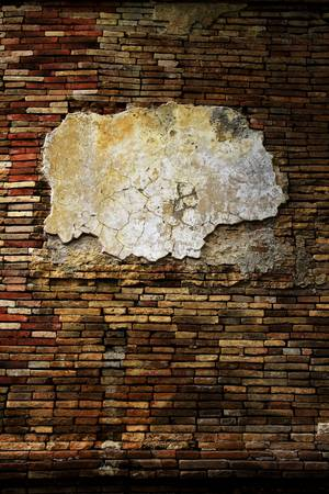 Old grunge brick wall with frame for text or picture. photo