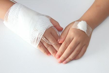 adhesive bandage: Children hand with bandage