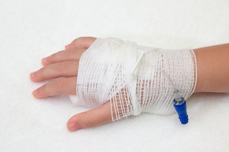 Hand of little girl with bandaged Stock Photo - 10181324