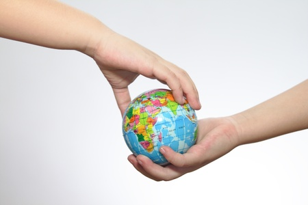 The globe in hands of the child. photo