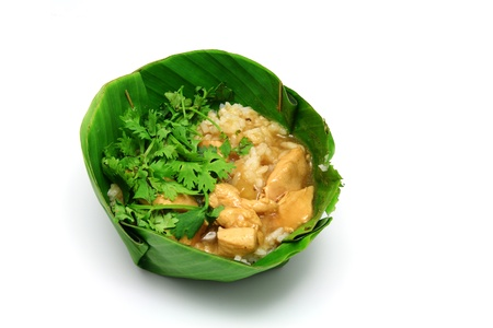 Chicken Rice have coriander on Banana leaf photo