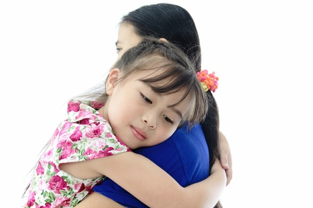 to cuddle: Close Up Of Affectionate Mother And Daughter on white isolated background Stock Photo