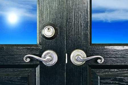door handle: Door handles with an old double door have sun and sky background