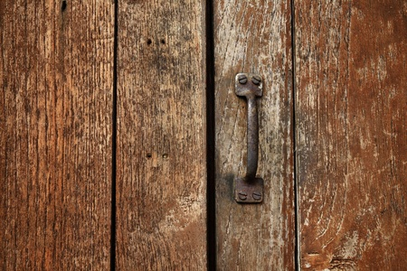 Handle on the old wooden door