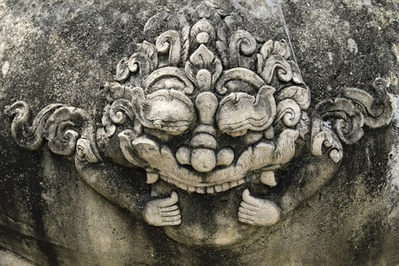 cambodia sculpture: Stone giant head thai style  in chet yot temple, Chiang Mai Thailand.