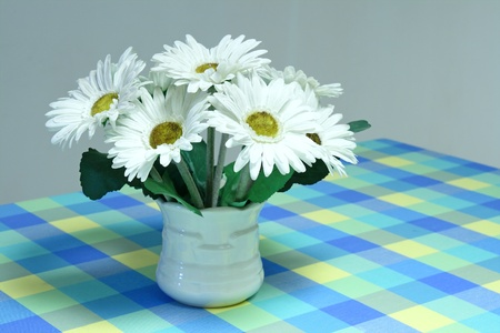 White artificial flower bouquet for Autumn and Winter image background on sweet table photo