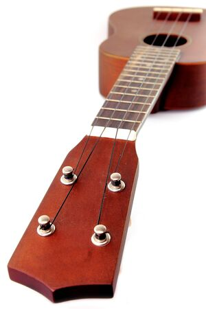 Vintage closeup ukulele  on white isolated. Stock Photo - 10181478