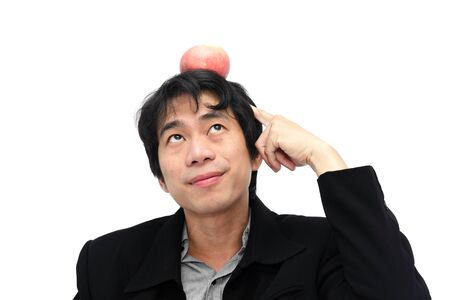 Business man get idea with red apple on the head photo