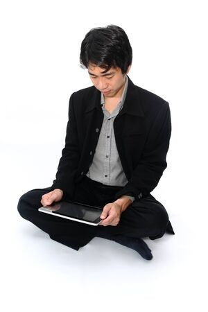 Businessman relax sitting with a digital tablet photo