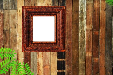 Picture frame on the old wooden wall photo