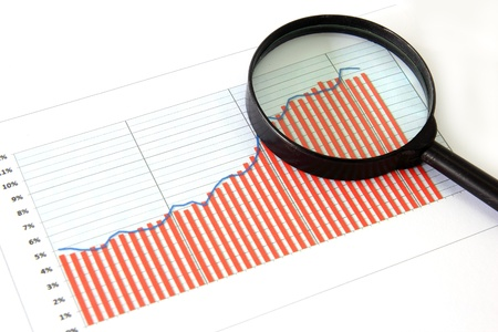 Magnifying glass focusing on a graph Stock Photo - 10537916