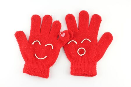 Pair of red winter gloves with happy face Stock Photo - 10573807