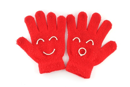 Pair of red winter gloves with happy face Stock Photo - 10573806