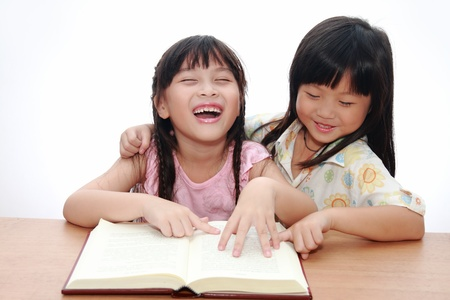 Cute little asian girl happy reading book photo
