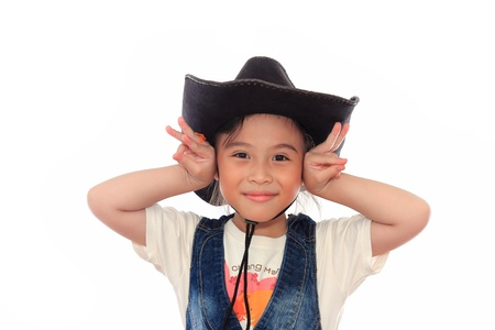 Beautiful asian girl in a cowboy hat photo