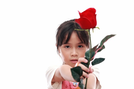 girl in red dress: Beautiful child girl giving red rose flower  Stock Photo