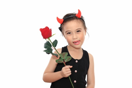 scary cute little asian girl in black halloween costume give red rose stock photo