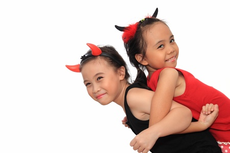 kids dress: Scary cute little asian girl in black and red Halloween costume.