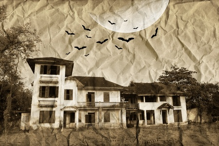 Mysterious house under the moon on crumpled paper photo