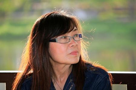 senior asian woman relaxing  photo