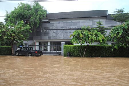 CHIANG MAI THAILAND - SEPTEMBER 29 : Flooding in Chiangmai city.Flooding of buildings near the Ping River on September 29,2011 in Chiangmai, Thailand Stock Photo - 11016892