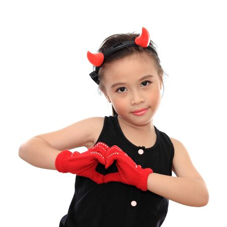 Beautiful little asian girl with heart sign photo