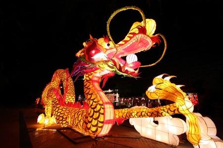 Beautiful illuminated Dragon Lantern in Chinese Happy new year Lantern Festival or Yee Peng Festival, Chiangmai Thailand photo