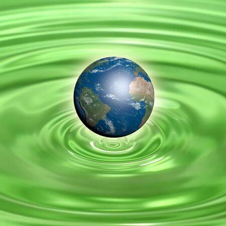 Earth globe on green water photo