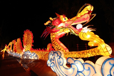 chinese new year dragon: Beautiful illuminated Dragon Lantern in Chinese Happy new year Lantern Festival or Yee Peng Festival, Chiangmai Thailand Stock Photo