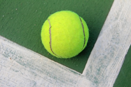 Tennis ball on a tennis court Stock Photo - 11473676