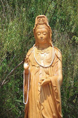 mercy: Kuan Yin with bamboo background