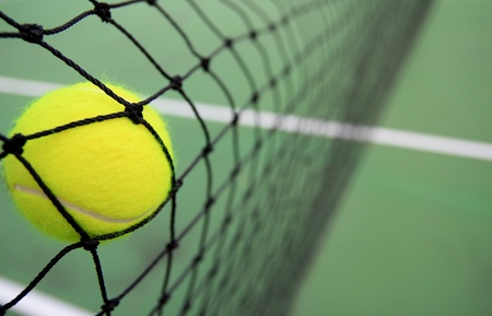Tennis ball in net photo