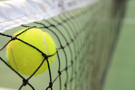 Tennis ball in net Stock Photo - 11647415