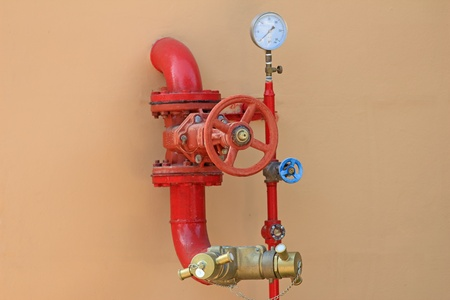 fire fighting equipment: fire hose on a wall Stock Photo