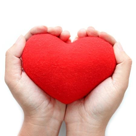 cuore nel le mani: Cuore simbolo rosso sulle mani Archivio Fotografico