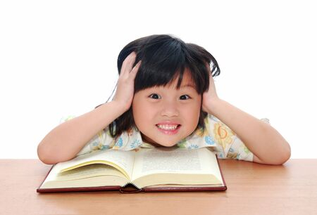 Intelligent little girl  reading a book Stock Photo - 11803367
