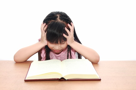 intelligently: serious little girl  reading a book