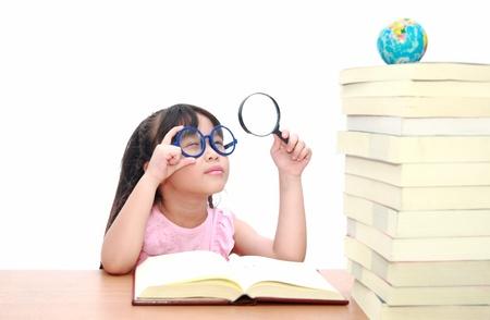 intelligently: Intelligent little girl  reading a book